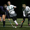 Manchester: Grace Gillette, right, and Olivia Colpoys rush in to keep the ball way from Swampscott's Jennifer Desmond during the Division 2 North first round field hockey tournament held at Hyland Field Wednesday night. Mary Muckenhoupt/Gloucester Daily Times