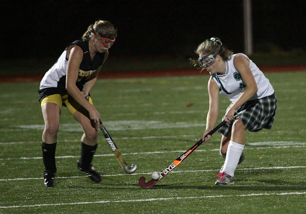 Manchester Essex's Melissa Moore gets the ball past Bishop Fenwick's Kathryn Hart during the MIAA Division 2 North Semi Finals last night. Photo by Kate Glass/Gloucester Daily Times