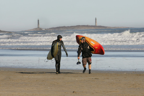 Gloucester: Ronnie MacNeil, left, and Dominic Capozzi head out after a day of enjoying the big surf at Good Harbor Beach Saturday afternoon.  Both said they enjoyed the water on what was almost a summer-like day. Mary Muckenhoupt/Gloucester Daily Times