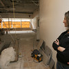 Manchester: P.J. O'Clair looks out at what will become a pilates studio at Clubxcel on School Street in Manchester. She hopes to open the club in early December. Photo by Kate Glass/Gloucester Daily Times