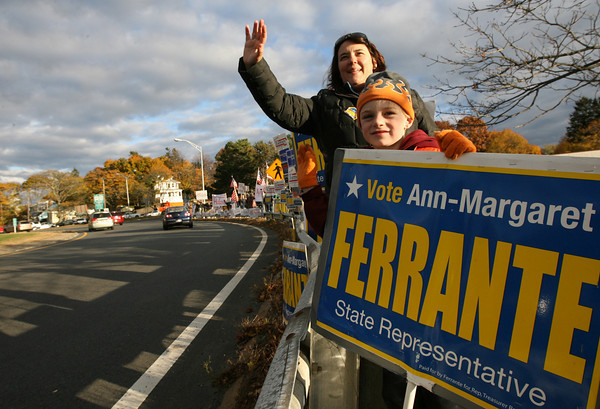 Gloucester: Ann-Margaret Ferrante, Democratic candidate for State Representative, stands at Grant Circle with Neville Clancy, 6, yesterday evening. Although Clancy is not old enough to vote, he said he would vote for Ann-Margaret. Photo by Kate Glass/Gloucester Daily Times