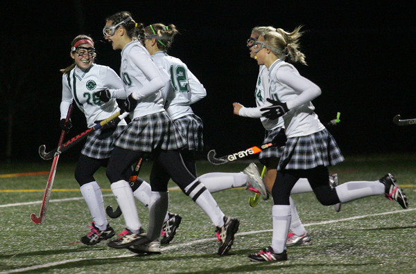 Manchester: Manchester Essex's Hannah Beardsley turns back to smile at her teammates after the Hornets scored their forth goal during the Division 2 North first round field hockey tournament held at Hyland Field Wednesday night. Mary Muckenhoupt/Gloucester Daily Times