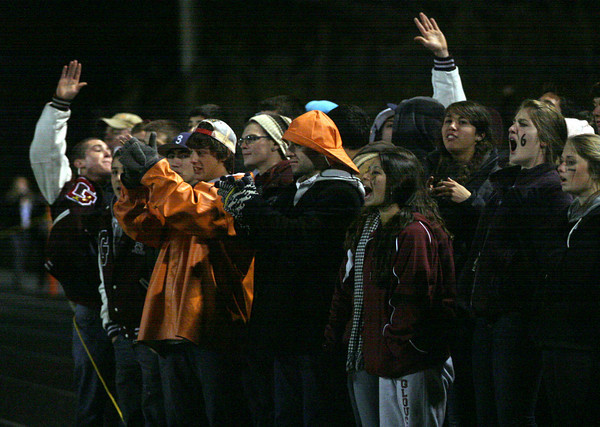 Sudbury: Gloucester fans cheer on the Fishermen as they play Lincoln Sudbury during the Division 1A semi-final at Lincoln Sudbury Regional High School last night. Photo by Kate Glass/Gloucester Daily Times