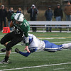 Manchester: Manchester Essex captain Alex Carr dodges a tackle by Georgetown's Derek Depasquale during yesterday's Thanksgiving Day Game at Hyland Field. Photo by Kate Glass/Gloucester Daily Times