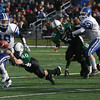 Manchester: Georgetown quarterback Tyler Wade tries to break a tackle by Manchester Essex's Trippe Reineman during yesterday's Thanksgiving Day Game at Hyland Field. Photo by Kate Glass/Gloucester Daily Times