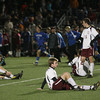 Weymouth: Rockport's Chandler Burnham, left, Sam Scatterday, and Cam Tibert remain on the field as Dover-Sherborn celebrates their 2-1 overtime win over the Vikings in the state semi-finals at Weymouth High School last night. Photo by Kate Glass/Gloucester Daily Times