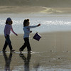 Gloucester: Gemma Chatham, 8, and her sister Gianna walk on Good Harbor Beach Saturday afternoon.  The sisters enjoyed building sandcastles and were happy to be at the beach in November. Mary Muckenhoupt/Gloucester Daily Times