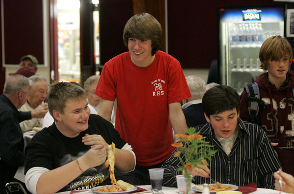 Rockport: Rockport sophomore Sam Cunningham, center, checks in to see how juniors Brian Amero, left, and Seth Perkins are enjoying their pasta at the Rockport High School class of 2013 Fundraiser which served up baked ziti in the school cafeteria Wednesday night. Also pictured is eighth grader Andrew Gleckner, right. Mary Muckenhoupt/Gloucester Daily Times