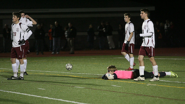 Weymouth: Rockport's Andrew Burnham, Andrew Visnick, Caden Tibert, Alex Hauck, and goalie Keady Segel watch as Dover-Sherborn celebrates their 2-1 overtime win over the Vikings in the state semi-finals at Weymouth High School last night. Photo by Kate Glass/Gloucester Daily Times