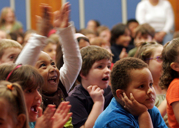 """Gloucester: Chantel Avila, a kindergartener at Veterans Memorial School, raises her hands in applause during """"A Friendship Adventure with Ronald McDonald"""" yesterday morning. The program was sponsored by the local McDonalds restaurant and focused on anti-bullying. Photo by Kate Glass/Gloucester Daily Times"""