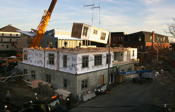 Gloucester: The first floor of the new apartments on the Lorraine site is put in place yesterday afternoon. The new building will have 25 apartments and be four stories high. Photo by Kate Glass/Gloucester Daily Times