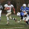 Danvers: Gloucester Gilbert Brown runs ahead of Danvers defenders during the Thanksgiving Day Game at Deering Field Thursday morning. Mary Muckenhoupt/Gloucester Daily Times