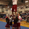 Gloucester: The Gloucester High School cheerleaders and football player Jordan Shairs hoist captain Mike Tomaino during a pep rally at the Benjamin A. Smith Fieldhouse yesterday morning. Photo by Kate Glass/Gloucester Daily Times