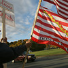 Gloucester: Carlos Hernandez of the North Shore Tea Party stands at Grant Circle yesterday to show support for his candidates. Photo by Kate Glass/Gloucester Daily Times