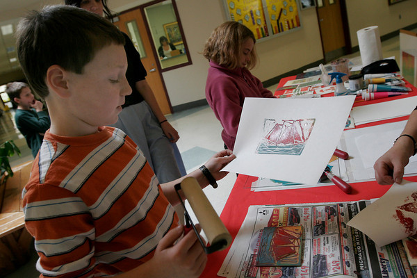 Rockport: Tres Morrell, a fourth grade student at Rockport Elementary School, looks over a print he made while doing a workshop with Rockport Art Association member Elizabeth Harty. Harty offers adult classes at the RAA on Mondays from 10-1 through the second week in December. Photo by Kate Glass/Glouceter Daily Times