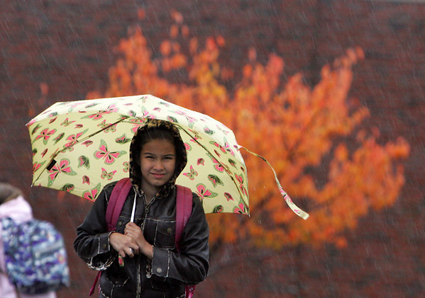 Rockport: Clara Mazo, a third grader at Rockport Elementary School, braves the wind and rain while walking out of school Wednesday afternoon.  Rain moves out for today and tomorrow but showers may be back over the weekend amking for a damp Halloween.  Mary muckenhoupt/Gloucester Daily Times