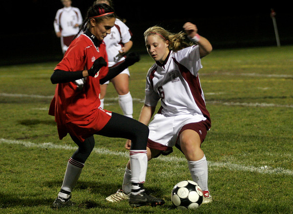 Gloucester: Gloucester's Abby Quinn and Saugus' Gabriella Cogliano battle for the ball at Newell Stadium last night. Photo by Kate Glass/Gloucester Daily Times Wednesday October 21, 2009
