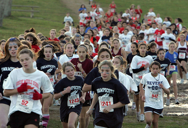 Gloucester: Girls cross country run their race course through Stage Fort Park in Gloucester at the Northeastern Conference Middle School Championship Thursday afternoon. Mary Muckenhoupt/Gloucester Daily Times