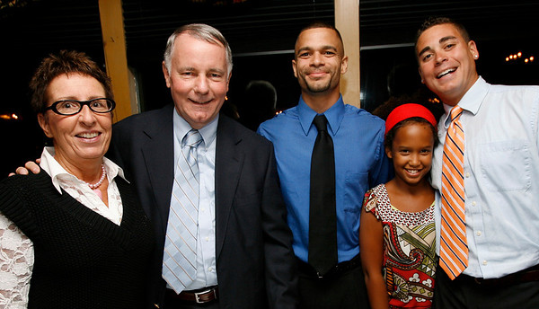 George Robertson with his wife, Christine, and children, Charlie, Nadia, and Thomas, at a party celebrating his 40 years with the Rockport DPW last night. Photo by Kate Glass/Gloucester Daily Times