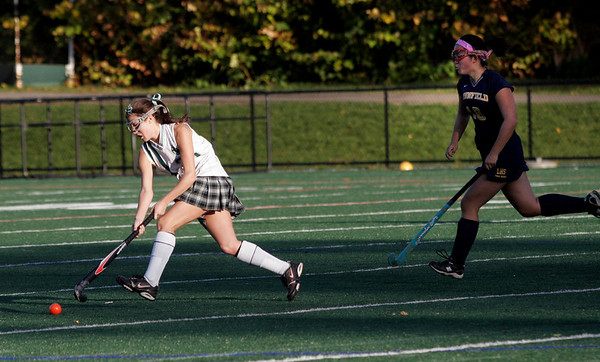 Manchester: Manchester Essex's Amelia Burke sprints ahead of Lynnfield's Lisa Neal at Coach Ed Field Field yesterday. Photo by Kate Glass/Gloucester Daily Times Monday, October 19, 2009