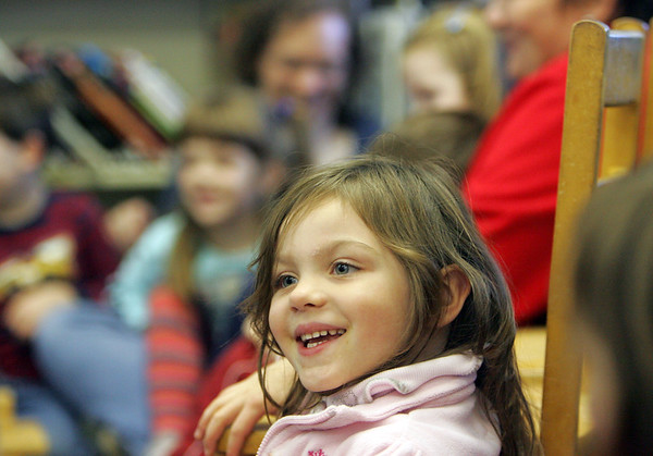 Essex: Sadie Lower, 4, of Gloucester listens to a story about pumpkins on Halloween at the TOHP Burnham Library story hour Thursday afternoon.  Mary Muckenhoupt/Gloucester Daily Times