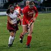 Gloucester: Gloucester's Hilary Ellis chases down Everett's Lisa Alyward at Newell Stadium last night. Photo by Kate Glass/Gloucester Daily Times Thursday, October 8, 2009