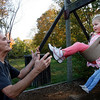 "Essex: Tim Hamilton pushes his granddaughter, Jessica Hamilton, 3, on the swings behind Essex Elementary School on Wednesday afternoon. When Tim asked Jessica who his favorite person in the world was, she smiled and said, ""me."" ""You're right,"" he said. Photo by Kate Glass/Gloucester Daily Times Wednesday, October 21, 2009"