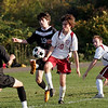 Rockport: Rockport's Shaffy Roell and North Andover's Evan Dudney battle for the ball as Gareth Dudney, left, and Brendan Douglass, right, look on yesterday afternoon. Photo by Kate Glass/Gloucester Daily Times Tuesday, October 20, 2009