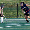 Manchester: Manchester Essex's Hannah Beardsley maneuvers around Lynnfield's Angela Arakelian at Coach Ed Field Field yesterday. Photo by Kate Glass/Gloucester Daily Times Monday, October 19, 2009