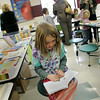 "Rockport: Naomi Woodson, 9, finds a bit of peace and quiet amongst the crowd to read the book ""Ivy and Bean"" by Annie Barrows and Sophie Blackall at the annual book fair at Rockport Elementary School Wednesday afternoon.  The book fair also included a free ice-cream social that began at 5 p.m.. Mary Muckenhoupt/Gloucester Daily Times"