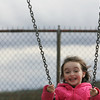 Essex: Jenny Baker, 4, of Essex giggles as she swings at Memorial Park playground Saturday afternoon. Mary Muckenhoupt/Gloucester Daily Times