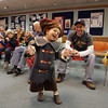 "Gloucester: Jackson Altieri, 3, of Gloucester dances in front of his dad Mark to a Halloween version ""Down By the Bay"" sang by storyteller Lucille LePage in the Children's Room of the Sawyer Free Library Saturday morning.  Lucille LePage told Halloween stories, songs and more to help get kids in the spirit of Halloween. Mary Muckenhoupt/Gloucester Daily Times"
