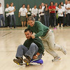 Manchester: Assistant principal Paul Murphy pushes Joe Lucido as the faculty race against the football team on dollies during the pep rally held at Manchester Essex High School Friday afternoon. Mary muckenhoupt/Gloucester Daily Times
