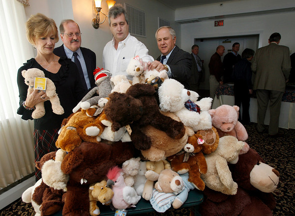 Gloucester: Ruth Pino, Jack Doyle, Josh Arnold, and Brad Pierce organize teddy bears collected by the Rotary Club for the Department of Children and Families during a luncheon at the Gloucester Elks Lodge yesterday afternoon. Photo by Kate Glass/Gloucester Daily Times Tuesday October 20, 2009