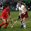 Gloucester: Gloucester's Meg Keagan and Everett's Yasmine Akib battle for the ball during their game at Newell Stadium last night. Photo by Kate Glass/Gloucester Daily Times Thursday, October 8, 2009