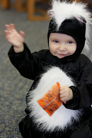 Gloucester: Zachary Welch, 1 year, waves in his skunk costume at the Sawyer Free Library Saturday morning.  Zachary and his mom Neva came to the library to hear Lucille LePage tell Halloween stories. Mary Muckenhoupt/Gloucester Daily Times