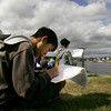 Gloucester: Seiken Okada draws Gloucester harbor from the Destino house on Rocky Neck during with her eigth grade language arts class Thursday morning.  O'Maley Middle School eigth graders took a field trip to learn about perspective and Fitz Henry Lane so were taken to locations he painted from. Mary Muckenhoupt/Gloucester Daily Times