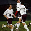 Gloucester: Gloucester's Chris Peritore hugs teammate Ben Hannah as Kevin Hurd runs alongside them celebrating Peritore's goal in the first half of their game against Salem. Photo by Kate Glass/Gloucester Daily Times Tuesday, October 13, 2009