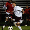 Gloucester: Gloucester's Christian Favalora fights past Salem's Nuur Muhamed at Newell Stadium last night. Photo by Kate Glass/Gloucester Daily Times Tuesday, October 13, 2009