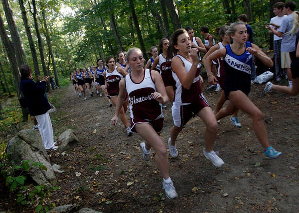 Gloucester: Gloucester's Krystina Novella and Samantha Oliver compete in their meet against Swampscott yesterday at Ravenswood Park yesterday. Photo by Kate Glass