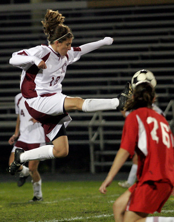 Gloucester: Katie Ciaramitaro leaps to connect with the ball during their game against Saugus at Newell Stadium last night. Photo by Kate Glass/Gloucester Daily Times Wednesday October 21, 2009
