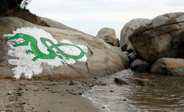 Gloucester: The city of Gloucester wants to clean the whitewash off the boulder at Cressey's Beach -- and the new dragon with it, but they are reaching out and welcoming the artist to repaint it.<br /> Photo by Kate Glass/Gloucester Daily Times Tuesday, October 27, 2009