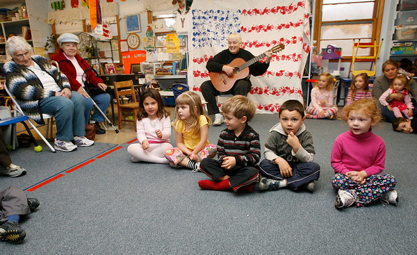 """Manchester: Carol Mead and the children at Shore Nursery School perform """"Five Little Pumpkins"""" for members of the Manchester Council on Aging yesterday afternoon during a Halloween Sing-Along. Photo by Kate Glass/Gloucester Daily Times Wednesday, October 28, 2009"""