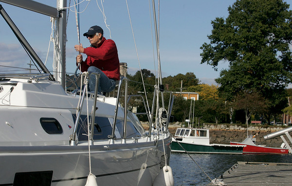 Manchester: Dale Spencer of Manchester de-rigs his sailboat euphoneous whale as he gets ready to take the boat of the water for the season at Manchester Harbor by Masconomo Park Wednesday afternoon.  Spencer planned to get one more day of sailing in the weekend but with weather reports calling for rain he thought it wise to get the boat ready for winter early with the help of his wife Pam amd son Bill. Mary Muckenhoupt/Gloucester Daily Times