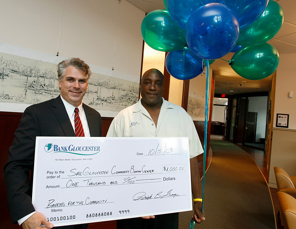Gloucester: Patrick Thorpe, President of BankGloucester, presents Martin Stephan of SailGloucester a check for $1,000 for finishing third in their community grants balloting. SailGloucester was a write-in candidate. Photo by Kate Glass/Gloucester Daily Times Monday, October 5, 2009