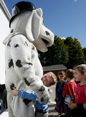 Manchester: William Kirby, a kindergarten student at Manchester Memorial School, hugs Sparky the Fire Dog during a fire safety demonstration at the school on Tuesday. The Manchester Fire Department also hosted an open house Tuesday night to teach families about fire prevention. Pizza and balloons were provided. Photo by Kate Glass/Gloucester Daily Times Tuesday, October 6, 2009