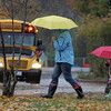 Rockport: Kristen Christopher and her daughter Lily, 4, walk over to pick up Lily's older sister Emma at Rockport Elementary School in the wind and rain Wednesday afternoon.  Mary Muckenhoupt/Gloucester Daily Times