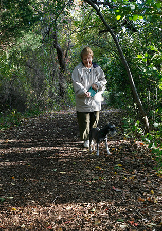 Rockport: Eileen Silva of Lanesville walks her dog, Dolly, at Halibut Point on Wednesday afternoon. Silva says she only brings her into the woods a little bit because she barks at all the dogs. Photo by Kate Glass/Gloucester Daily Times Wednesday, October 7, 2009<br /> , Rockport: Eileen Silva of Lanesville walks her dog, Dolly, at Halibut Point on Wednesday afternoon. Silva says she only brings her into the woods a little bit because she barks at all the dogs. Photo by Kate Glass/Gloucester Daily Times Wednesday, October 7, 2009