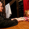 Gloucester: Ella Tucker, 2, peeks up at her mom as she gets her fortune read by Johnna Santos at the Camp Spindrift Haunted Woods. The haunting grounds will be open from 5 to 10 p.m. October 22-25, 29-30, and 5 to 9 p.m. on Halloween. The event is a fund-raiser for next year's Horribles parade. Photo by Kate Glass/Gloucester Daily Times Thursday, October 22, 2009