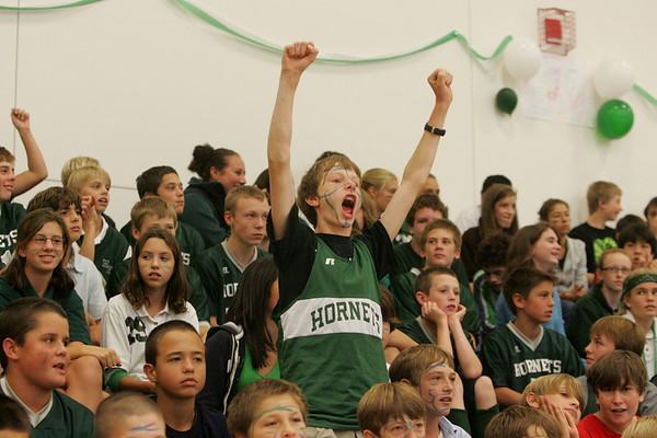 Manchester: Manchester Essex seventh grader Andy Creighton stands up and cheers for his school during the fall sports pep rally held in the gymnasium of the Manchester Essex High School Friday afternoon. Mary Muckenhoupt/Gloucester Daily Times